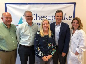 Dr. Michael Lantz taking photo with Chesapeak Health Care Team